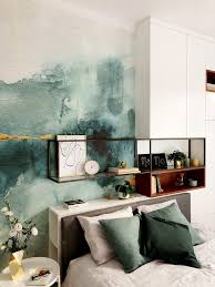 green bedroom with abstract watercolor wallpaper and