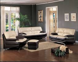 Brown Leather Sofa Living Room Ideas by Living Room Cream And Black Leather Sofa On Brown Wooden Floor