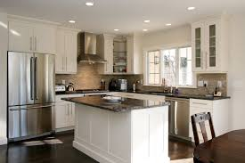 white wooden kitchen island with black counter top and white