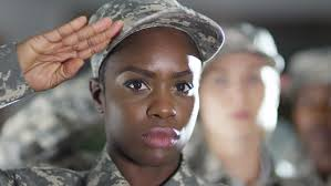 4K Close Up On Faces Of Mixed Ethnicity Female Soldiers Standing To Attention And Saluting