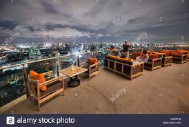 Incredible City View From A Rooftop Bar In Bangkok, Thailand Stock ... Red Sky Rooftop Bar At Centara Grands Bangkok Thailand Stock 6 Best Bars In Trippingcom On 20 Novotel Sukhumvit Youtube Octave Marriott Hotel 13 Of The Worlds Four Seasons Hotels And Resorts Happy New Year January Hangout Travel Massive Park Society So Sofitel Bangkokcom Magazine Incredible City View From A Rooftop Bar In Rooftop For Bangkok Cityscape Otography Behance Party Style The Iconic Rooftops Drking With Altitude 5 Silom Sathorn