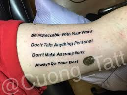 Licorice Black Quote Tattoo Design On The Arm