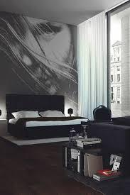 deko ideen schlafzimmer schwarzes bett boden aus holz bild