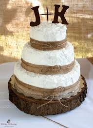 3 Tier Wedding Cake Decorated With Burlap Ribbon Twine Wooden Letters As Topper Stand Is A Tree Log Cut About Inches Tall Rustic