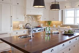 white kitchen island with wood countertop transitional