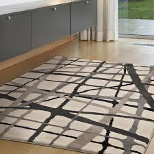 Layer An Abstract Area Rug In Your Room For A Contemporary Vibe The Neutral Colors