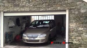 Garage Door Bottom Seal For Uneven Floor by Sloped Bottom Garage Doors For Uneven Thresholds Youtube