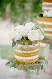 Naked wedding cake with white roses so pretty and classy