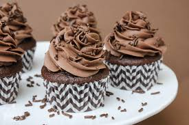I topped mine off with some yummy chocolate sprinkles which kind of makes them a quadruple chocolate cupcake…right