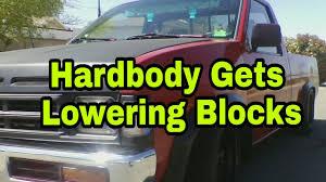 Nissan Hardbody Gets Lowering Blocks. - YouTube