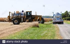 100 Fertilizer Truck A Terra Gator Crop Sprayer Is Filled From A Supply Truck Carrying