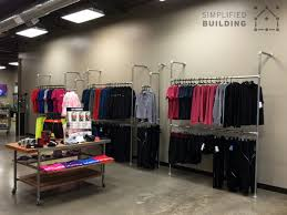 Best Wall Mounted Clothing Racks How To Use Them Effectively Regarding Store Plan