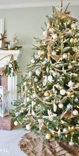 The Addition Of Shells And Starfish Mixed With Burlap Gold Touches Creates A Stunning Relaxed Coastal Feel For This Christmas Tree