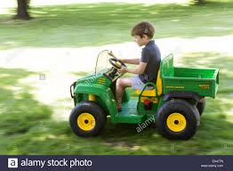 100 John Deere Toy Trucks Young Boy Driving Gator Truck USA Stock Photo