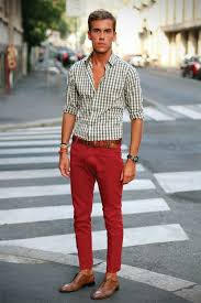 Red Pants With A Brown Belt And Dark Shoes