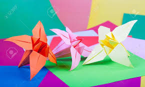 Paper Flowers Of Lily Against Colour Stock Photo