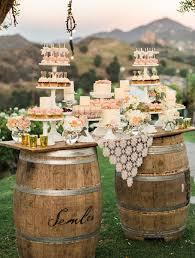 Rustic Wedding Dessert Table With Barrels