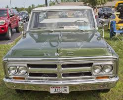 COMBINED LOCKS, WI - AUGUST 18: Front View Of A Green 1970 GMC ... Hot Wheels Chevy Trucks Inspirational 1970 Gmc Truck The Silver For Gmc Chevrolet Rod Pick Up Pump Gas 496 W N20 Very Nice C25 Truck Long Bed Pick Accsories And Ck 1500 For Sale Near O Fallon Illinois 62269 Classics 1972 Steering Column Fresh The C5500 Dump Index Wikipedia My Classic Car Joes Custom Deluxe Classiccarscom Journal