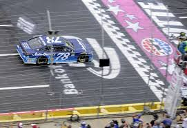 Martin Truex Jr Takes The Checkered Flag To Win A NASCAR Cup Series Auto Race