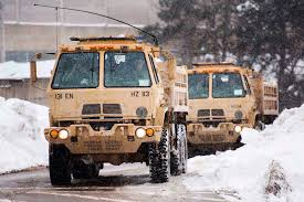 100 Trucks In Snow National Guard Soldiers Drive Heavy Wheeled Trucks While Helping