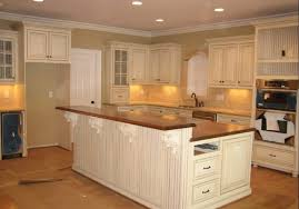 kitchen cabinets brown countertop fireplace home white ceiling