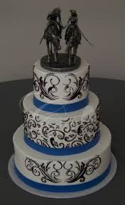 wedding cake with black stencil and blue base band