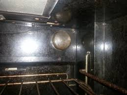 trying to remove glass cover for light bulb in viking oven