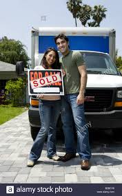 100 Moving Truck For Sale Young Couple In Front Of Moving Truck Holding Sign Stock