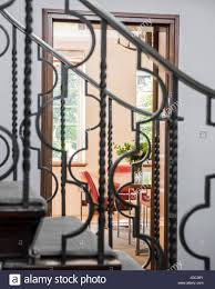 View Through Wrought Iron Banister To Dining Room In 1930s Art ... Sol Kogen Edgar Miller Old Town Feature Chicago Reader Model Staircase Black Banister Phomenal Photos Design Best 25 Victorian Hallway Ideas On Pinterest Hallways Hallway Avon Road Residence By Bhdm 10 Updating A 1930s Colonial House To Rails Top Painted Stair Railings Ideas On Skylight And Lets Review All My Aesthetic Choices In One Post Decoration Awesome Fixtures Wall Lights Over White Color I Posted Beauty Shot Of New Banister Instagram The Other Chads Crooked White Oak Staircases 2 Paint Out Some Silver Detail Art Deco Home Stock Photo Royalty Spindles Square Newel