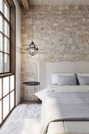 Exposing Raw And Rough Brick Walls Is One Of The Popular Renovation Ideas Designing With Bricks Exposed Stone Wall Transformed A Hotel