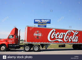 A Coca-Cola Truck Passing WALMART SUPERCENTER, Kendallville, United ... Hundreds Que For A Picture With The Coca Cola Truck Brnemouth Echo Cacola Truck To Snub Southampton This Christmas Daily Image Of Hits Building In Deadly Bronx Crash Freelancers 3d Tour Dates Announcement Leaves Lots Of Children And Tourdaten Fr England Sind Da 2016 Facebook Cola_truck Twitter Driver Delivering Soft Drinks Jordan Heralds Count Down As It Stops Off Lego Ideas Product Delivery