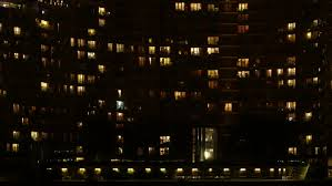 light in the windows of a multistory building minsk time lapse