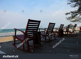 Rocking Chairs On Patio Near Beach Stock Photo (Edit Now ... Wooden Puppet On The Wooden Beach Chair Blue Screen Background Outdoor Portable Cheap Rocking Chairpersonalized Beach Chairs Buy Chairpersonalized Chairsinflatable Chair Product Coastal House Art Blue Sharon Cummings Tshirt Miniature Of A In Front Lagoon Hot Item High Quality Telescope Casual Sun And Sand Folding Bluewhite Stripe Version Stock Image Image Coastal Print Cat In A On The Stock Tourist Trip Summer Travel White Alexei Safavieh Fox6702c Bay Rum Na Twitteru Theres Rocking