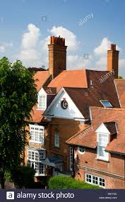 terracota tiles and brick chimneys on an arts and crafts style