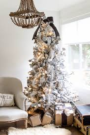 Two Flocked Christmas Trees A Review Tree With Wooden Chandelier