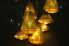tom dixon s dazzling geometric cell lights shine like jewels