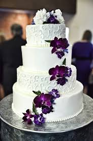 White and purple wedding cake with cascading purple flowers Copyright Bello Romance graphy