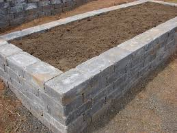 raised bed made out of stone patio and yard Pinterest