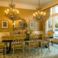 Formal Yellow Victorian Dining Room With Double Chandelier