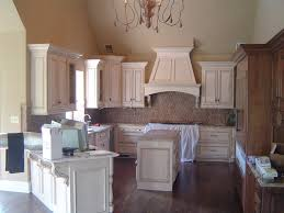 Schuler Cabinets Knotty Alder by Cream Glazed Custom Cabinetry Photos