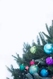 An Outside Christmas Tree Decorated With Bright Balls Made Of Glass Against White Background The