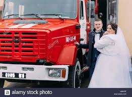 Happy Wedding Couple Posing Near Big Red Fire Truck Stock Photo ... Shop North American Big Rig Red Semi Truck Alarm Clock Wlights Book Review 7 Id Like To Be A Fireman The Yellow Shelf Super Lego Technic Fire Engine Wih Lifting Basket With A Ladder Closeup Stock Photo Picture And During Image Bigstock Special Equipment At Sunset Isolated On Royalty Free 36642 Big Red Truck Duh David Cote Kxmx Local News Sallisaws New Will Be Greg Happy Wedding Couple Posing Near Big Red Fire Truck Engine With Pipes And Flasher On The Roof At Summer Day