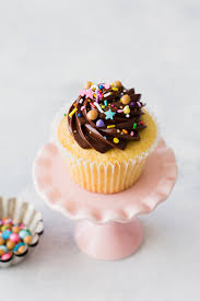 Perfect Fluffy Yellow Cupcakes Crowned With A Swirl Of Rich Chocolate Frosting
