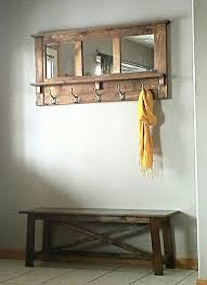 We Have Recovered A Chic DIY Pallet Mirrored Coat Rack Out Of Wood Which Can Accent Greatly Any Entry Way Or Hallway