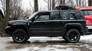 Lifted Jeep Patriot. 235/65r17 Cooper Discoverer AT3 Tires, 2.125in ...