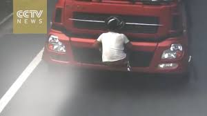 Chinese Man Covers License Plate Of Moving Truck With Body - YouTube