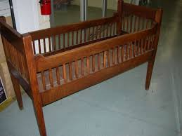 Furniture Antique Brown Stained Wooden Baby Nursery Bed With