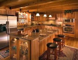 pendant lights and stainless appliances highlight this log home