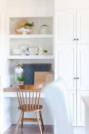 A Small Kitchen Nook Is Decorated For Spring With These Simple And Easy To