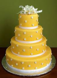 This Rose and Yellow wedding cake by Maisie Fantaisie is ideal for those who love the